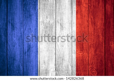 France flag or white or blue, white and red French banner on wooden background - stock photo
