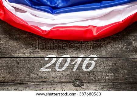 France Flag with the Date 2016 on wooden background, concept Football and EM