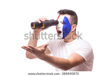 France football fan look at game of France national football team over binoculars and angry scream on white background. European football fans concept.