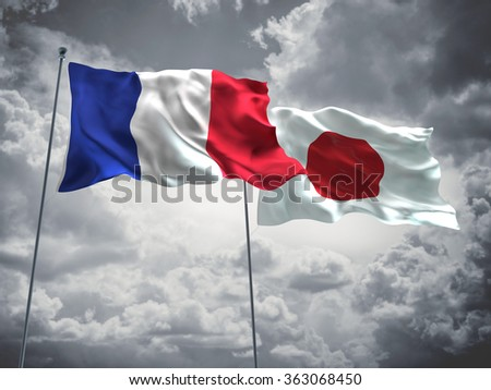 France & Japan Flags are waving in the sky with dark clouds  - stock photo