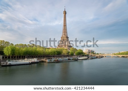 France landmarks - The Eiffel tower in Paris from the river Seine in spring season. Paris, France - stock photo