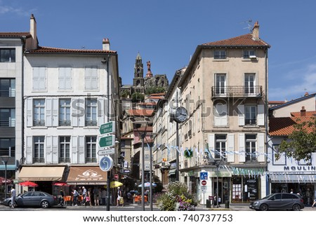 France, Le Puy-en-Velay: Street scene with iron statue of Virgin Mary (Notre-Dame de France) and Cathedral of Our Lady of the Annunciation (Cathedrale Notre-Dame du Puy), August 07, 2017