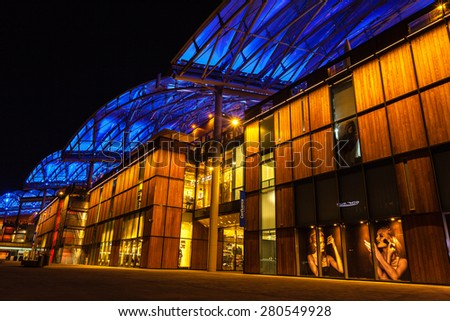 FRANCE, LYON - FEBRUARY 19: The Confluence District in Lyon, France on February 19, 2013. New district with an modern architecture in the place of the old port. Night shot - stock photo