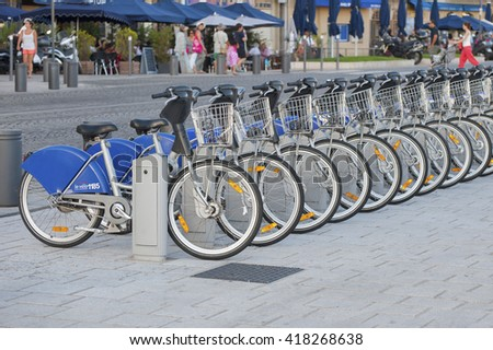 FRANCE, MARSEILLE - AUGUST 6, 2013: Bikes for rent in the port of Marseilles. - stock photo