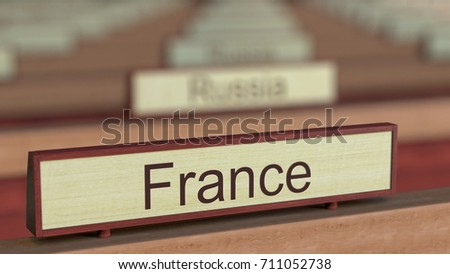 France name sign among different countries plaques at international organization. 3D rendering