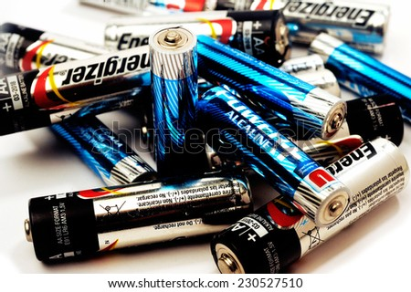 FRANCE - NOVEMBER 9: Recycling of used batteries of different brands on white background, november 9, 2014. - stock photo