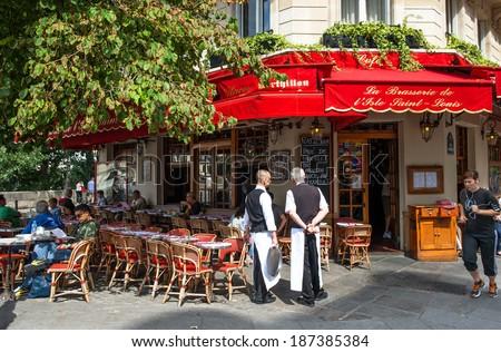 FRANCE, PARIS - AUGUST 24, 2013: street scene in traditional Parisian cafe near famous Notre Dame de Paris on August 25, 2013 in Paris, France - stock photo