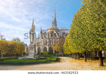 France. Paris. Cathedral of Notre Dame de Paris in sunny autumn in backlit sunbeam with vintage camera lense look.
