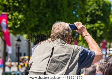 FRANCE, PARIS - JUNE 06: Man taking pictures on the street on June 06, 2015