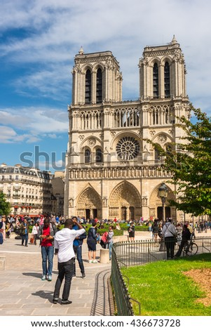 FRANCE, PARIS - JUNE 01: Tourists enjoy sightseeing near the Cathedral of Notre Dame in Paris  on June 01, 2015