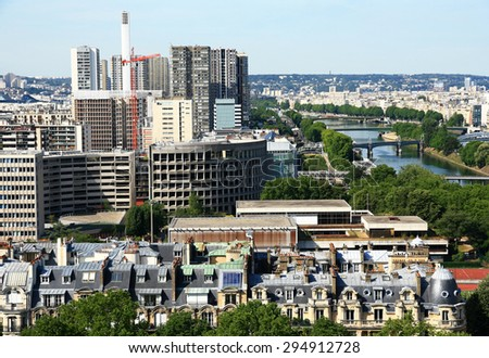 FRANCE. PARIS - JUNE 25, 2015: View on the quay of the river Seine and the modern buildings of Paris.