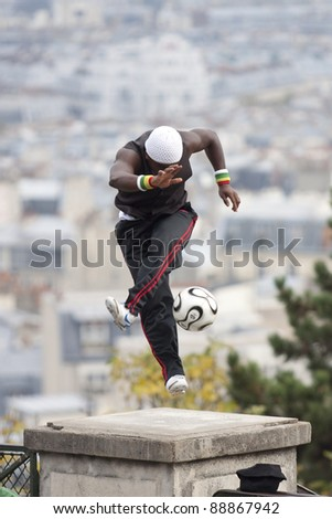 FRANCE, PARIS - NOVEMBER 4: Iya Traore - a professional soccer player makes a soccer freestyle demonstration in front of Basilica Sacre Coeur. November 4, 2011 in Paris, France. - stock photo