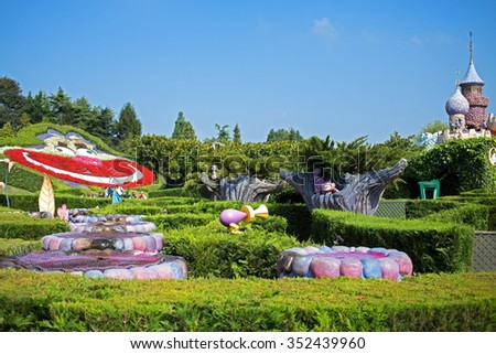 FRANCE, PARIS - 10 SEP, 2014: Labyrinth with Cheshire cat by Alice in Wonderland fairy-tale on Disneyland. - stock photo