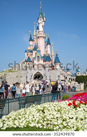 FRANCE, PARIS - SEP 10, 2014: Many tourists are walking near castle of Disneyland. - stock photo
