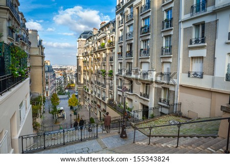 France. Paris. Streets of Montmartre in sunny autumn afternoon. - stock photo