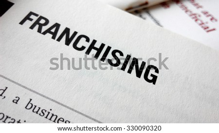 Franchising word on a book. Business success concept - stock photo