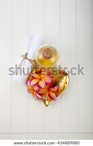 frangipani flower and massage oil with hand towel - stock photo