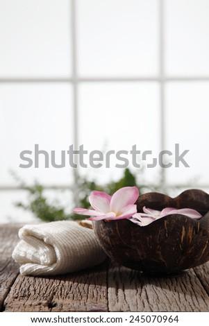 frangipani flower ,hand towel and coconut shell  - stock photo