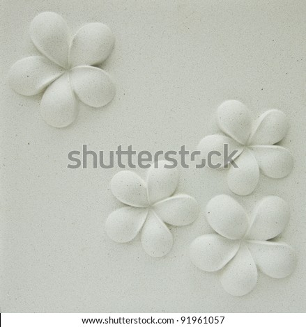 Frangipani flower motifs on the walls, plaster, natural color. - stock photo