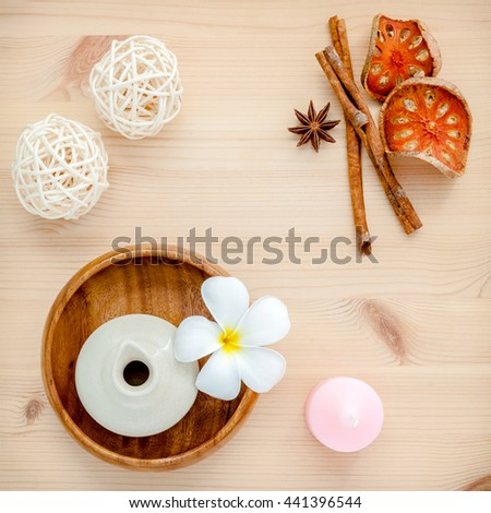 Frangipani tropical flowers with herbal spa products . Plumeria flowers with aromatic oil . Thai spa theme aromatherapy  with herbal. Relaxation with herbal essential oil. - stock photo