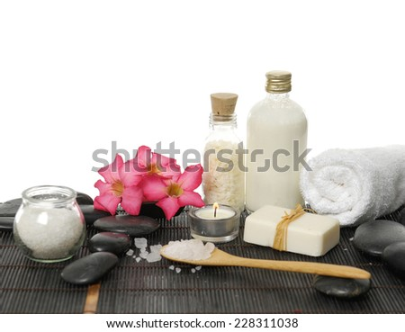 frangipani with stones ,candle, salt in glass, towel ,candle on mat background - stock photo