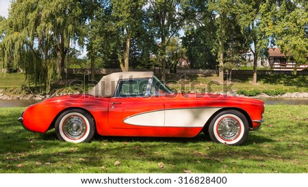 FRANKENMUTH, MI/USA - SEPTEMBER 13, 2015: A 1957 Chevrolet Corvette car at the Frankenmuth Auto Fest, held in Heritage Park. - stock photo
