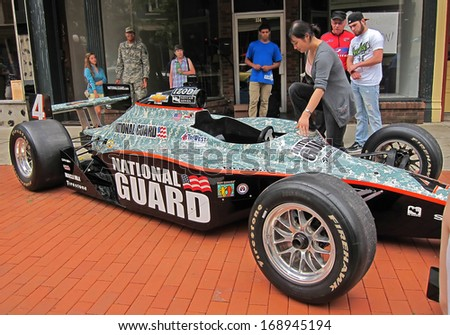 FRANKFORT, KY/USA - May 5, 2012:  This National Guard race car was drawing a crowd of onlookers at the street fair during the Kentucky Derby 2012.                             - stock photo