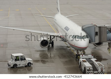 FRANKFURT AIRPORT, GERMANY - DECEMBER 1, 2015: Aegean Airlines jet at Frankfurt Airport. Frankfurt Airport is a major international airport.  Aegean is the largest Greek airline.