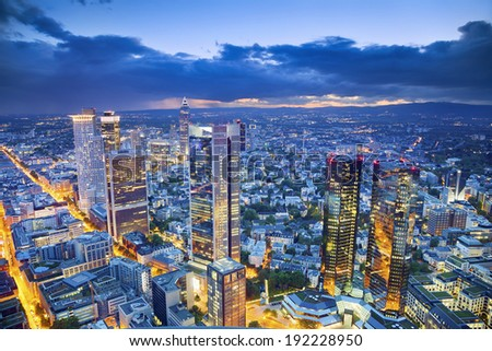 Frankfurt am Main. Aerial view of Frankfurt am Main skyline during twilight blue hour. - stock photo