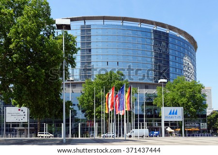 FRANKFURT AM MAIN, GERMANY - AUGUST 7, 2015: Congress Center part of Messe Frankfurt (Trade Fair) venue.  Its tasks involve marketing the exhibition grounds for conferences and conventions. - stock photo