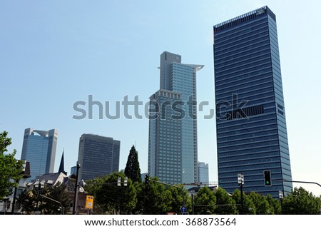 FRANKFURT AM MAIN, GERMANY - AUGUST 7, 2015: Highrise buildings, left to right -Trianon, FBC, Westend, Tower 185. Frankfurt is an international financial city with the most imposing skyline in Germany - stock photo