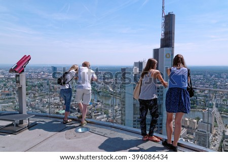 FRANKFURT AM MAIN, Germany - August 6, 2015: Visitors at the public viewing platform of the Main Tower - a 56 storey, 200 m high skyscraper named after the Main river. - stock photo