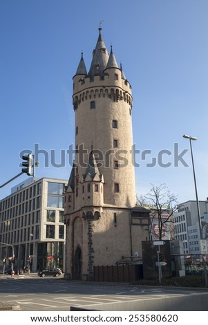 FRANKFURT AM MAIN, GERMANY - FEBRUARY 7, 2015: Eschenheim Tower is the oldest building in the largely reconstructed new town of Frankfurt. Photo taken on February 7, 2015 in Frankfurt am Main. - stock photo
