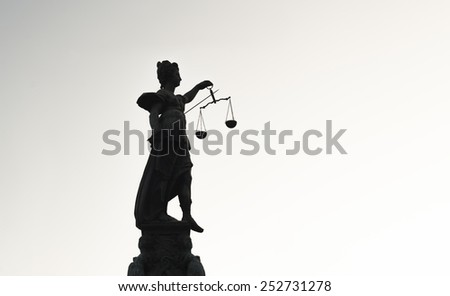 FRANKFURT AM MAIN, GERMANY - FEBRUARY 6, 2015: high contrast photo of statue of Lady Justice, known as the Roman goddess of Justice. Photo taken on February 6, 2015 in Frankfurt am Main city, Germany. - stock photo