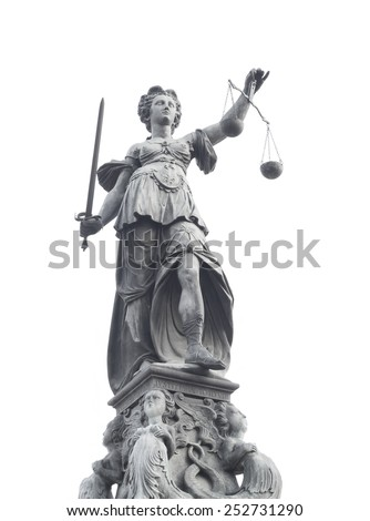 FRANKFURT AM MAIN, GERMANY - FEBRUARY 6, 2015: isolated photo of statue of Lady Justice, known as the Roman goddess of Justice. Photo taken on February 6, 2015 in Frankfurt am Main city, Germany. - stock photo