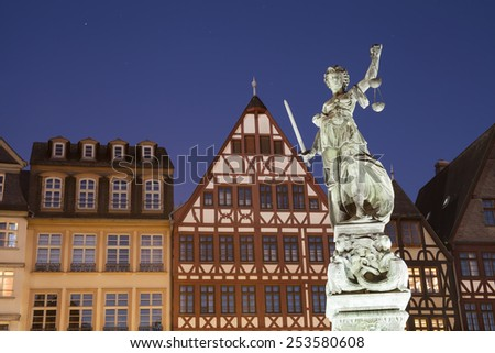 FRANKFURT AM MAIN, GERMANY - FEBRUARY 6, 2015: night photo of statue of Lady Justice, known as the Roman goddess of Justice. Photo taken on February 6, 2015 in Frankfurt am Main city, Germany.  - stock photo