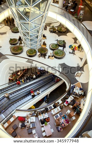 FRANKFURT AM MAIN, GERMANY - JAN 10, 2015: The escalator and sitting area in Myzeil shopping centre.  - stock photo