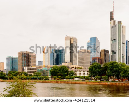 FRANKFURT AM MAIN, GERMANY - JUNE 11, 2015: Skyscapers from accros Main river of Frankfurt am Main, Germany. Frankfurt is the largest city in the German state of Hesse