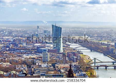 FRANKFURT AM MAIN, GERMANY - MAR 3, 2015: The new seat of the European Central Bank in Frankfurt am Main, Germany. A 185 165-metre-twin-skyscraper located east of the city centre.