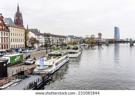FRANKFURT AM MAIN, GERMANY - NOVEMBER 14, 2014: Wonderful autumn view of embankment of river Main from famous Eiserner Steg bridge. Frankfurt am Maine - financial center of Germany.