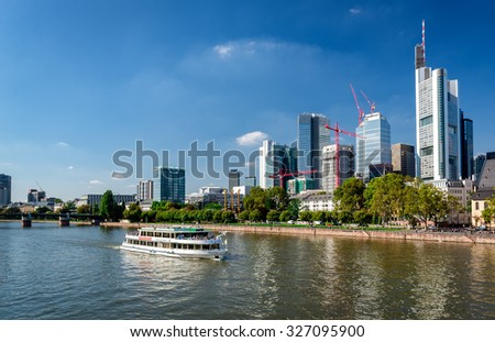 Frankfurt am Main, Germany- September 24, 2013: Boat cruise through the Main river and skyscrapers of Frankfurt am Main downtown. Germany