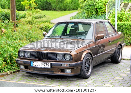 FRANKFURT AM MAIN, GERMANY - SEPTEMBER 16, 2013: Brown BMW E30 3-series retro car at the city street.