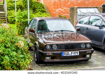 FRANKFURT AM MAIN, GERMANY - SEPTEMBER 16, 2013: Motor car BMW E30 3-series in the city street.