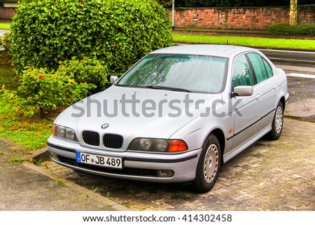 FRANKFURT AM MAIN, GERMANY - SEPTEMBER 14, 2013: Motor car BMW E39 5-series in the city street. - stock photo