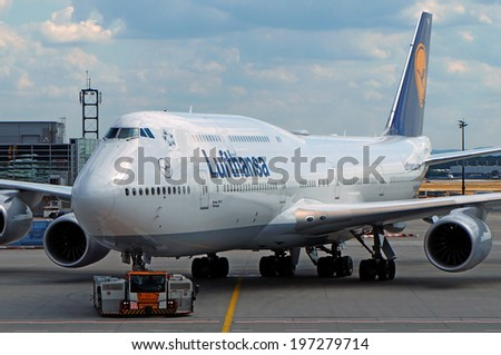 FRANKFURT - August 18: Lufthansa Boeing 747-8 Intercontinental pushed back for departure at Frankfurt international airport on August 18, 2013. Lufthansa is the launch customer of B747-8I. - stock photo