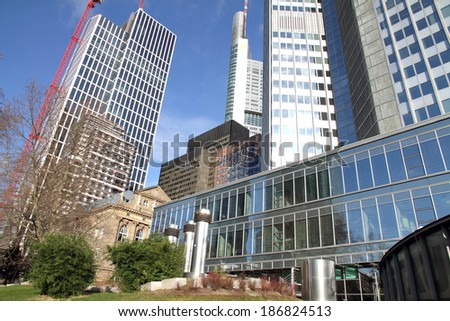 FRANKFURT - DECEMBER 9: Bottom view of skyscrapers in the central business district of Frankfurt am Main, on December 9, 2013 in Germany. Frankfurt is a largest financial centre in Europe.