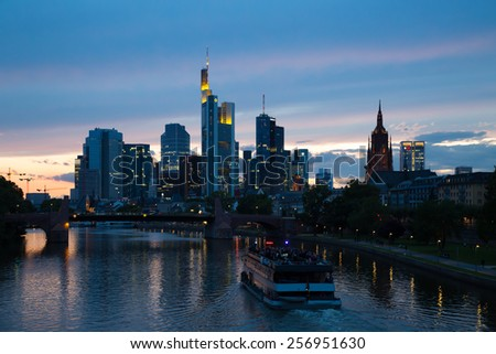 Frankfurt evening skyline. Mainhattan skyscrapers. River Main embankment. Sunset over Frankfurt. Germany business center. Germany financial. Frankfurt financial. Sunset cloudscape.Sunset sky.Urban sky