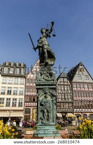 FRANKFURT, GERMANY- APR 8, 2015:Justitia Statue at the Romer square, one of the oldest and most historic sections of Frankfurt am Main, Germany, Europe. - stock photo