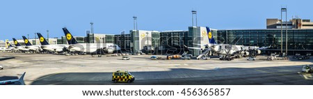FRANKFURT, GERMANY - APR 7, 2015: Terminal 1 with passengers airplane decking in Frankfurt, Germany. With 38 million passengers per year it is one of the most important airport in Europe.