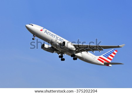 FRANKFURT,GERMANY-APRIL 10:airplane of American Airlines on April 10,2015 in Frankfurt,Germany.American Airlines, Inc. is a major American airline headquartered in Fort Worth, Texas. - stock photo